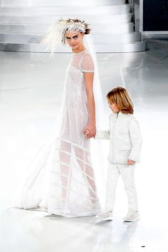 January 21  Cara Delevingne makes a young friend in five-year-old Hudson Kroenig, Karl Lagerfeld's godson, during the Chanel Couture show in Paris.