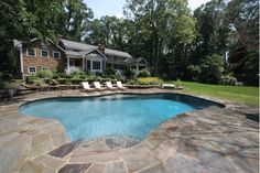 In-Ground Pool with Natural Stone Patio