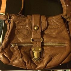 Brown CrossBody Purse Brown CrossBody Bag. Zipper and Snap Closure. Has one outside pocket (zipper) and one inside pocket (zipper). Includes slot for phone. Bags Crossbody Bags