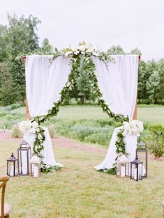 Ceremony Arch with Draping white fabric and white and green flowers by @englishgardennc Photography By: Casey Rose Photography Wedding Planner: @asouthernsoiree A Southern Soiree