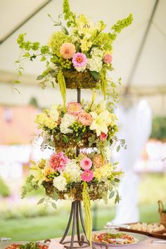 Summer wedding reception decor idea - bright, floral tiers decorated the reception {Caught You On Camera}