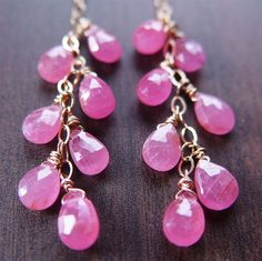 Delicate and sweet, these pink sapphire and 14 karat gold filled earrings are the perfect, elegant spot of color during this spring season.  Hand
