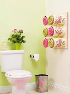 Bathroom organizing ideas - Towel storage made of decoupaged tin cans. - This is an ideal bathroom accessory that has an amazing look to it. You can do this by taking tin cans into for a towel storage unit. Coffee Can Crafts, Tin Can Crafts, Diy And Crafts, Towel Organization, Towel Storage, Organization Ideas, Towel Shelf, Diy Bathroom Decor, Bathroom Towels