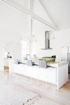 Vaulted ceilings, lining board clad island, hydronic heating panel under Island counter. vaulted-ceilings-white-dining-zone-habib