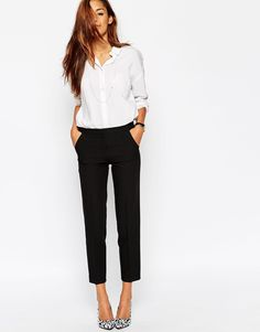 simple white button up + black trousers + printed pumps to add personality to fall work outfit