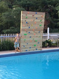 I Decided To Add Some Fun To The Pool By Building My Own Climbing Rock Wall That Hangs Over The Pool This Is A Diy Pool Climbing Wall Kids Backyard Trampoline