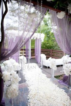 Wowee beautiful aisle for the bride in a white and lavender wedding