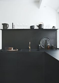 "Modern Kitchen Interior black modern kitchen with a plywood backsplash and shelf possible diy - //Sponsored post ""Black on black"" Black kitchens are very hot these days and I´m very happy that we chose the RIVA black oak kitchen from JKE Design when we"
