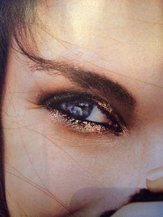 Lovely shiny gold eye make-up.