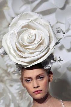 Katsuya Kamo, often the hats are made of paper.