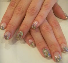 Glitter accents add a fun touch to a classic French manicure. There are so many different colours to choose from. Seen here is a combination of gold & purple