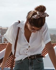 button up white tea and high waisted denim, with your hair tied up in a bun with a bandana. Visit Daily Dress Me at dailydressme.com for more inspiration
