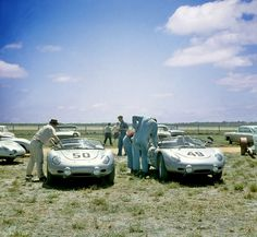 Porsche 718's at 1961 Sebring 12 Hour Two factory Porsches at Sebring in 1961. The #50 Porsche 718 RS 61 was driven by Hans Herrmann and Edgar Barth. The #49 718 RS 61 car was driven by Jo Bonnier and Dan Gurney. Neither car finished the race with one suffering engine problems and the other a blown clutch.