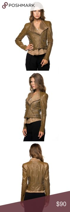 HPLeather Moto Jacket with Suede Contrast Trendy and stylish long sleeve moto jacket with faux suede inner layer.  Mid cropped style with pockets.  Fully lined with zipper front closure.  Color - Camel.        Size - S, M & L.     85% Polyester 15% Polyurethane Classic Paper Doll Jackets & Coats Utility Jackets