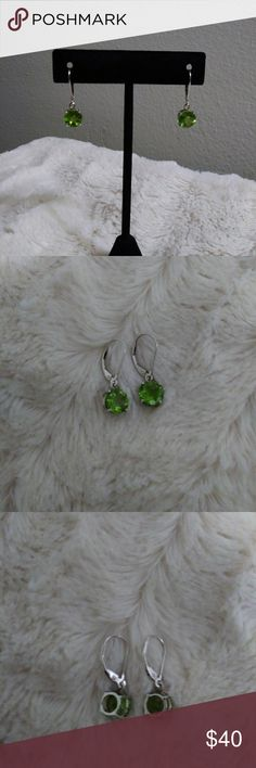 """Genuine Peridot Earrings These Beautiful Natural Peridot Earrings are from my own collection.(Always hated my birthstone because Peridot seemed cloudy and puse-then I started collecting GEMS!) This Peridot came from China. There are No inclusions to the naked eye. It's a beautiful deep lime green. Both stones perfectly match and are 8mm Round. Drop is 1"""". Gem weight is approx. 3 Carats. Set in Rhodium plated Sterling Silver Lever-back findings. Any Questions? Please ask. NO Low-Ball Offers…"""