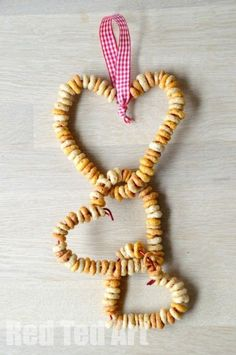 Exploring Winter Wild Life - make Cheerio Bird Feeders... these look so cute! and observe the birds in your area.