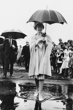 January 1977  Queen Elizabeth II steps gamely into a puddle during her visit to New Zealand, in 1977.