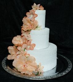 Fake cake decorated with wallpaper and flowers from bobeche.