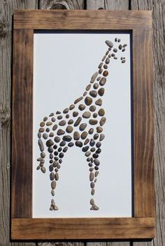 This Giraffe Rock Art was created with rocks from the eastern banks of Lake Michigan. Each rock was handpicked, cleaned, prepared and chosen for this particular piece of artwork. The frame was built specifically for this piece and is secured to the artwork. It has hanging wire attached to the back so it is ready to hang! The outside of the frame measures: 17.25w x 28.25h