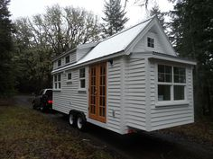 Very cute tiny home! At 172 sq. ft, this is way too small for my needs, but I LOVE the color scheme. would need it to be larger though. especially to have real steps to the loft. NOT a lader. Tiny House Movement, Tiny House Plans, Tiny House On Wheels, Tiny House Living, My House, Small Living, Tiny House Exterior, Micro House, Construction