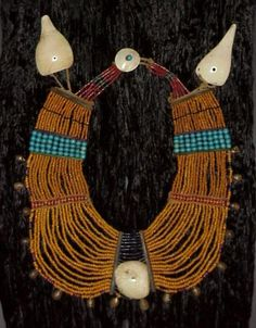 Naga Necklace,Phom Tribe | Rare Mustard Color Glass Beads, Spaced With Red Whiteharts, Sections Of Turquoise Padre Glass Beads, And A Center Of Blue Cobalt Glass. Each Section Is Bordered By Horn Separators With Ridged Brass Bells On Perimeter, Conch Shell Disc At Center.  | Pre 1920