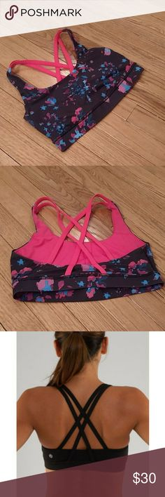 Lululemon Energy Bra Black lululemon energy bra with a hot pink and blue floral pattern. NWOT, in perfect condition. Super cute straps in the back, stock photos included to show fit. lululemon athletica Intimates & Sleepwear Bras