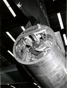 Sally Wadsworth, one of the tens of thousands of women generically referred to as Rosie The Riveter , cuts some safety wire in the tail gunner's station in a Vega-built B-17F Flying Fortress bomber in early 1943.  Vega Aircraft began as a wholly owned subsidiary of Lockheed Aircraft, but merged with the parent company in late 1941 and absorbed by Lockheed Aircraft in November 1943 Lockheed-Vega built 500 B-17Fs and 2250 B-17Gs under license at its plant