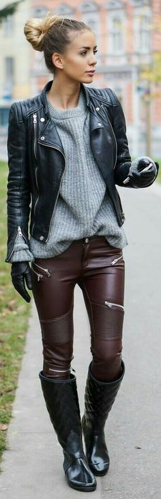 Maroon oxblood ribbed leather pants, gray sweater, black leather moto jacket and black quilted riding boots.