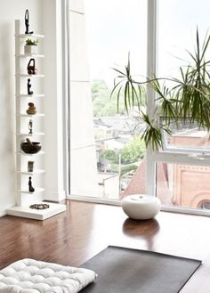 This airy penthouse yoga room has all the elements of the most serene yoga studio: natural air purifiers by way of a potted plant, hardwood floors for more stable Sun Salutations and asanas (poses), white and warm tones, and most important, unadorned windows that let in plenty of natural light.