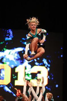 The 2013 Cheerleading Worlds Cheer Extreme Senior Elite. Grab foot and jump over. This would look so cool.
