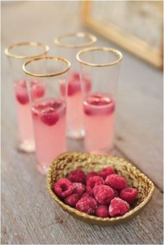 Place frozen raspberries in these gold rimmed glasses of champagne to create a whimsical wedding cocktail. Image: We Heart It
