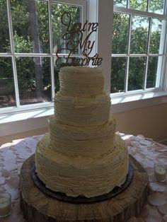 Beautiful wedding cake with ruffled ribbon buttercream
