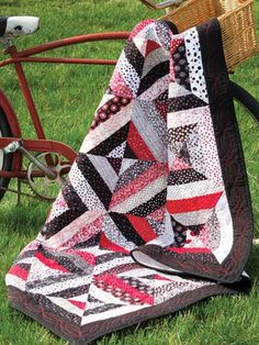 Yikes Stripes Quilt Pattern Download from e-PatternsCentral.com -- Stitch a fun and contemporary look with precut strips in bold black, white and red.