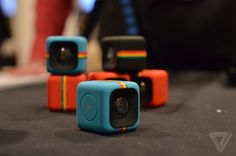 Polaroid unveils an adorable, tiny cube camera for action shots: the new 35-mm cube camera called the C3. It will ship for $99 later this summer. For its small size, the camera is packed full of a surprising degree of features, including a 120-degree wide-angle lens capable of capturing HD video, and still images up to 5 megapixels. It's waterproof up to 6.6 feet, and contains 2MB of internal storage, and a micro SD slot expandable up to 32 GB. It also has a microphone and an LED light.