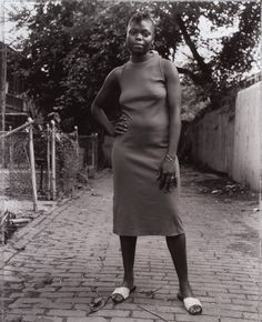 """untitled-1991:   """"a young woman between carrolburg place and half street""""washington, d.c. (1989)photographed by dawoud bey"""