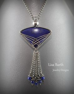 Here is a Lapis lazuli cab I wrapped in sterling wire. I was inspired by the shape of the stone. It reminds me of a Japanese fan, that is why I put the tassel dangling down.