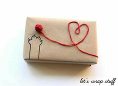 DIY Gift Wrapping for a Cat LoverI've seen so many gorgeous gift wrapping ideas - but none as easy and cute as this one. Find the DIY Yarn Ball Gift Wrapping Tutorial from Let's Wrap Stuff here. wrapping ideas for birthdays truebluemeandyou Diy Gift Wrapping Tutorial, Creative Gift Wrapping, Creative Gifts, Wrapping Gifts, Brown Paper Wrapping, Wrapping Papers, Gift Wrap Diy, Wrapping Paper Ideas, Diy Creative Ideas