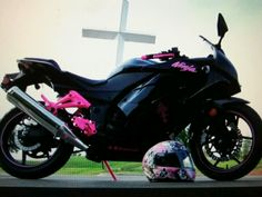 Ninja 250 black with pink accents.