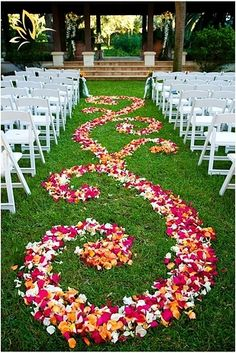 Unique aisle runner created from flower petals... We're definitely using flower petals for the aisle runner, I'll have to see if there's enough to do a swirly design!