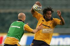Lote Tuqiri gets away from the tackle of Sam Cordingley during the Australian Wallabies Captain's Run held at Subiaco Oval, June 2006 in Perth, Australia. Perth Australia, Editorial News, June, Stock Photos, Running, Pictures, Photos, Keep Running, Photo Illustration
