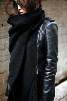 Leather jacket with oversized wraparound collar.