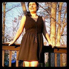 Black Lacey dress Black lace on top half of the back and front, silky feel to bottom half, criss-cross lace up the top for a little peek-a-boo opening. Hidden zip up left side. Knee-length (I'm 5 feet tall). Worn a few times. Forever 21 Dresses