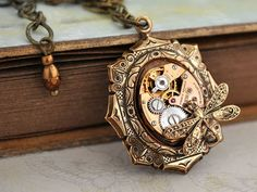 Items similar to steampunk necklace - TIME TRAVELER - vintage gold color watch movement necklace with tiny dragonfly on Etsy Silver Locket Necklace, Gold Locket, Silver Lockets, Watch Necklace, Steampunk Watch, Steampunk Fashion, Swarovski, Industrial Jewelry, Michael Kors Rose Gold