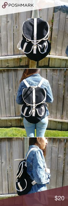 Forever 21 Black and White Backpack Great black and white faux leather backpack. Minimal design. Durable and made to last. Perfect for textbooks and carrying extra clothes. No flaws, good condition! Forever 21 Bags Backpacks