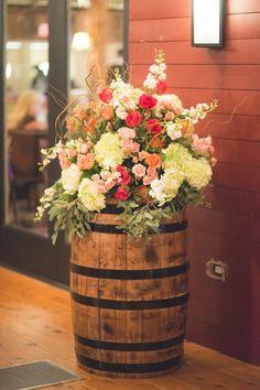 Rustic chic wedding decor - lush and colorful flower arrangements + antique wine barrels  {Brit Perkins Photography}