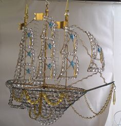 Canopy Designs Ship Chandelier. Brass frame, Turquoise and Yellow accents. Forgive my poor background... I hadn't gotten anyone to paint me a white wall yet!