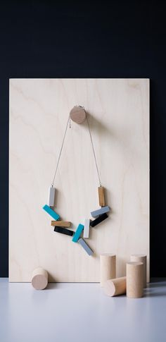 Featuring a connection of geometric blocks on a silver chain, pair this arty necklace with boxy silhouettes for a fashion-forward look.