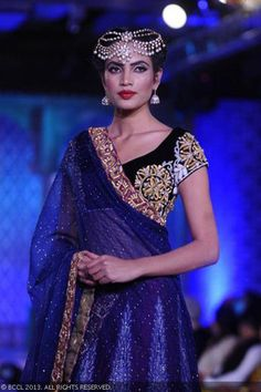 A model walks the ramp at Niki Mahajan's couture show, held at Le Meridien, New Delhi, on September 14, 2013.