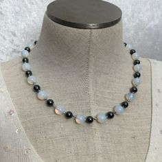 Hematite and opalite hand-knotted by VelvetCurtainDesigns on Etsy