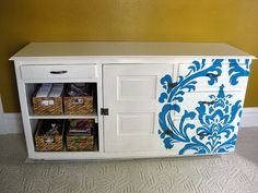 Fabric design transfered to transparency, projected onto dresser and handpainted.